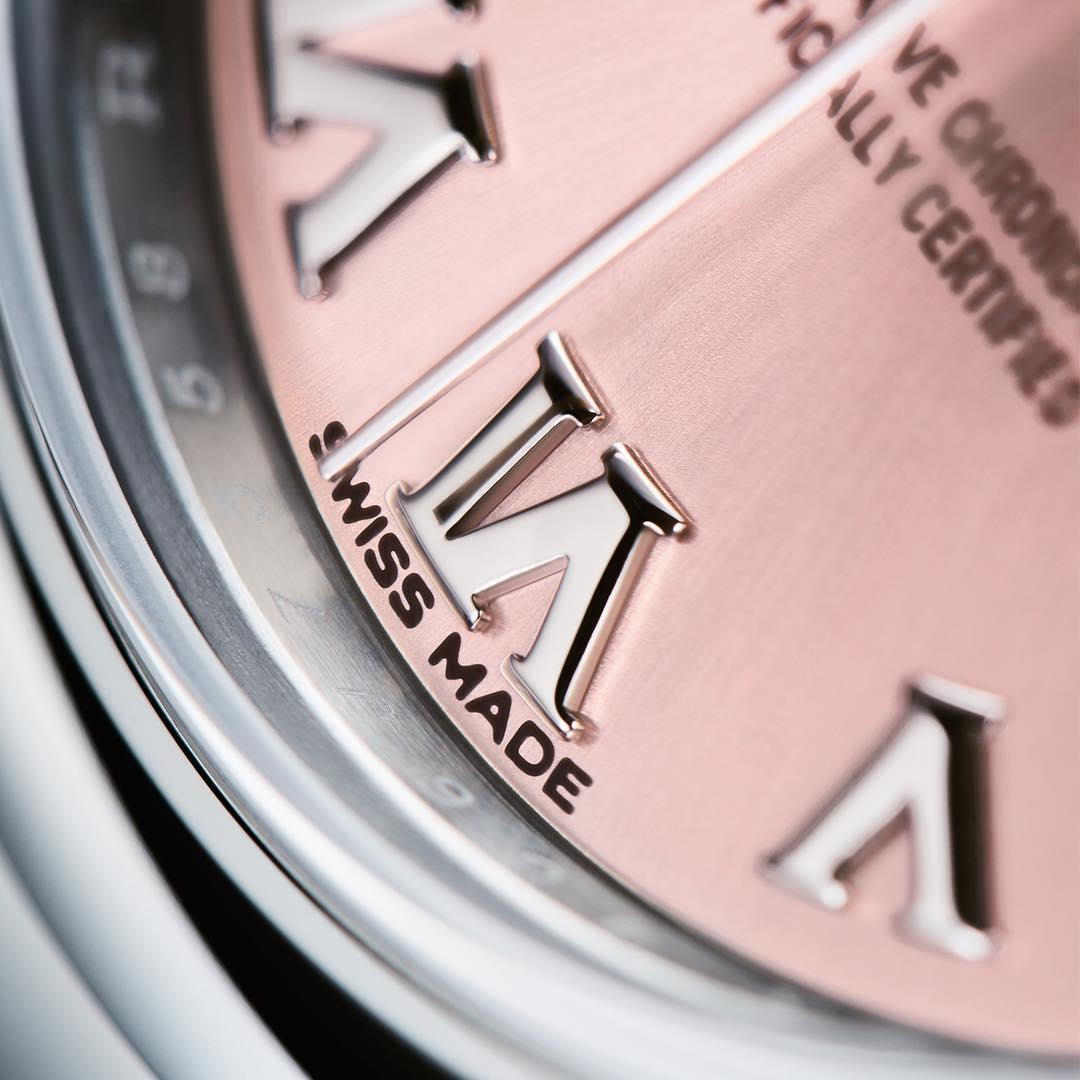 The Roman numerals in 18ct white gold on the pink, sunray-finish dial of the new Rolex Lady-Datejust 28 in 904L steel.
